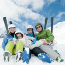 family skiing at a ski resort