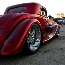 vintage car rims on a red sportster